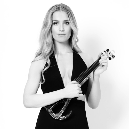 Jamie Lee from High on Heels holding a Violin