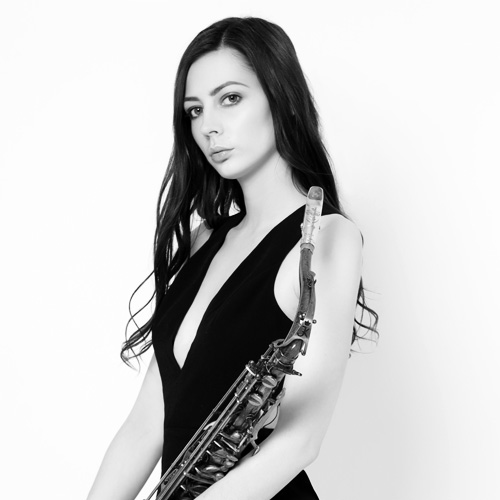 Kat from High on Heels holding a Saxaphone